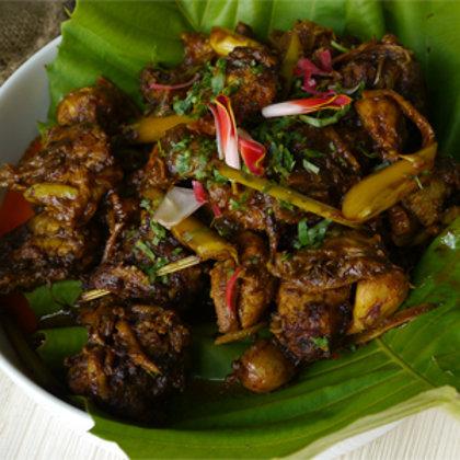 Stir fried sambal chicken with freshly foraged herbs