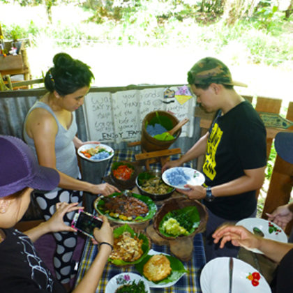 Sharing lunch served kampong style