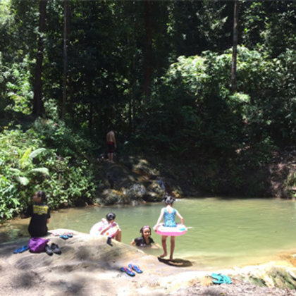 Enjoying a jungle waterfall where only the locals go